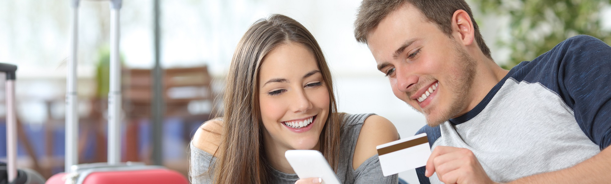 Couple holding phone and card