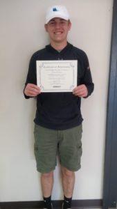 Scholarship winner Chase Gratopp holding certificate and scholarship check