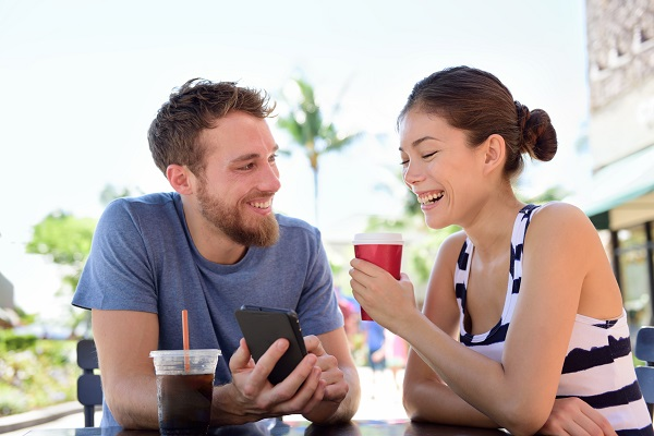 Couple at Cafe viewing smart phone