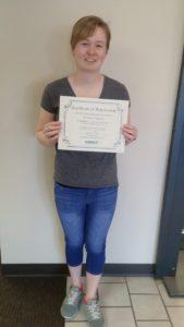 Scholarship winner Elizabeth Simpson holding certificate and scholarship check