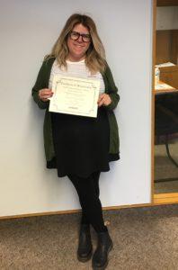 Scholarship winner Jessica McCauley holding certificate and scholarship check