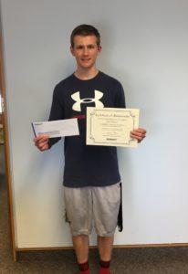 Scholarship winner Kyle Hanson holding certificate and scholarship check